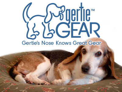 Gertie Gear logo, Gertie's Nose Know Great Gear tagline, photo of Gertie on olive with embroidered flowers pet air bed